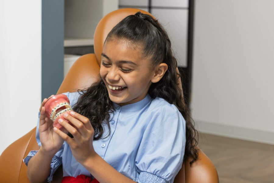 Young Patient Looks at Braces